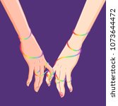 two women holding hands... | Shutterstock .eps vector #1073644472