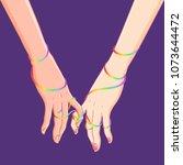 two women holding hands... | Shutterstock .eps vector #1073644472