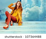 woman in autumn moscow city | Shutterstock . vector #107364488