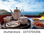 teapot cups and vegetarian food ... | Shutterstock . vector #1073703206