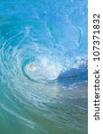 blue wave breaking into a tube... | Shutterstock . vector #107371832