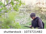 man ecologist conducts research ... | Shutterstock . vector #1073721482