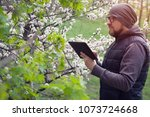 man ecologist conducts research ... | Shutterstock . vector #1073724668