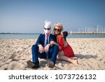 cheerful couple are sunbathing... | Shutterstock . vector #1073726132
