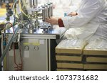 manufacturing and filling... | Shutterstock . vector #1073731682