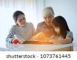 multi generation female members ... | Shutterstock . vector #1073761445