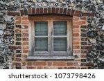 rustic brick cottage window... | Shutterstock . vector #1073798426