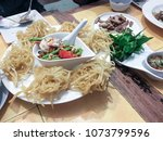 fried papaya salad serve in the ... | Shutterstock . vector #1073799596