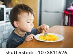 a child in a t shirt in the... | Shutterstock . vector #1073811626