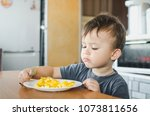 a child in a t shirt in the... | Shutterstock . vector #1073811656