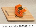 a papaya fruit is cut into... | Shutterstock . vector #1073821616