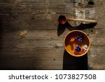 Small photo of Old Finnish Sauna SPA Concept, wooden pot with water, flowers and a bucket, a kettle with hot water and a massage snag, on old wooden rustic sauna boards, top view, copy space