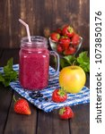 smoothie from strawberry ... | Shutterstock . vector #1073850176