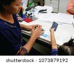 selective focus of a left hand... | Shutterstock . vector #1073879192