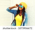 african woman with skateboard... | Shutterstock . vector #1073906672