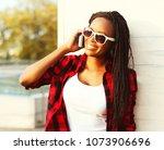 pretty woman talking on a... | Shutterstock . vector #1073906696