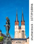 Small photo of View of Market Church of Our Dear Lady or Marktkirche Unser Lieben Frauen and Gobel Fountain in Halle (Saale), Germany, blue sky, sunset