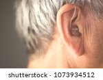 digital modern hearing aid in... | Shutterstock . vector #1073934512