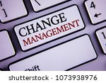 Small photo of Writing note showing Change Management. Business photo showcasing replace leaderships or People in charge Replacement written on white keyboard key with copy space Top view.