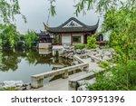 tinglin park  kunshan city ... | Shutterstock . vector #1073951396