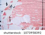 Small photo of Layers of ripped off wall posters, torn street billboard banners, parts of existing images