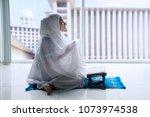 side view of muslim woman... | Shutterstock . vector #1073974538