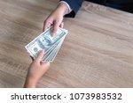 close up hand of business... | Shutterstock . vector #1073983532