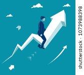 businessman sitting on rising... | Shutterstock .eps vector #1073988398