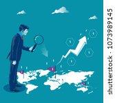 global investment. businessman... | Shutterstock .eps vector #1073989145