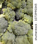 fresh broccoli on display for... | Shutterstock . vector #1073990345