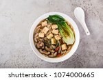 asian vegan noodle soup with... | Shutterstock . vector #1074000665