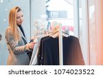 trendy young woman choosing... | Shutterstock . vector #1074023522