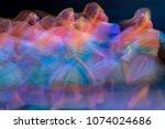 Small photo of Abstract movement in the dance. Children ensemble. Moscow. Russia