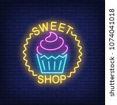 sweet shop neon sign. tasty... | Shutterstock .eps vector #1074041018