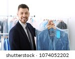 young businessman holding... | Shutterstock . vector #1074052202