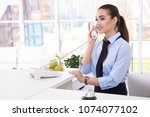 female receptionist talking on... | Shutterstock . vector #1074077102
