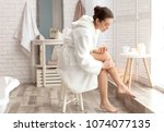 young woman applying natural... | Shutterstock . vector #1074077135