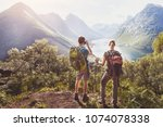 travel  couple of hikers with... | Shutterstock . vector #1074078338