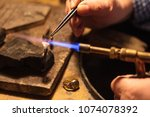 old jeweler at work on his...   Shutterstock . vector #1074078392