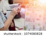 teacher writing on score chart... | Shutterstock . vector #1074080828