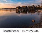 colorfull sunset at lake... | Shutterstock . vector #1074092036