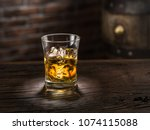 whiskey glass or glass of... | Shutterstock . vector #1074115088