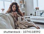 high temperature. sick young... | Shutterstock . vector #1074118592