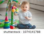 cute little child playing... | Shutterstock . vector #1074141788