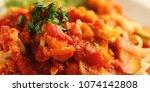ribbon pasta with arrabiata... | Shutterstock . vector #1074142808