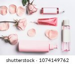 Stock photo pink natural cosmetic products with roses essential oil gel lotion serum and toner roses water 1074149762