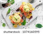 eggs benedict on english muffin ... | Shutterstock . vector #1074160595