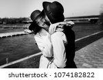 bride and groom on black hats...   Shutterstock . vector #1074182822