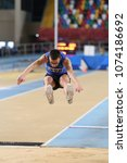 Small photo of ISTANBUL, TURKEY - JANUARY 06, 2018: Undefined athlete long jumping during Turkish Athletic Federation Olympic Threshold Indoor Competitions