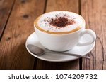cup of cappuccino coffee on... | Shutterstock . vector #1074209732